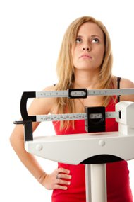 Woman Standing On The Scale Frustrated